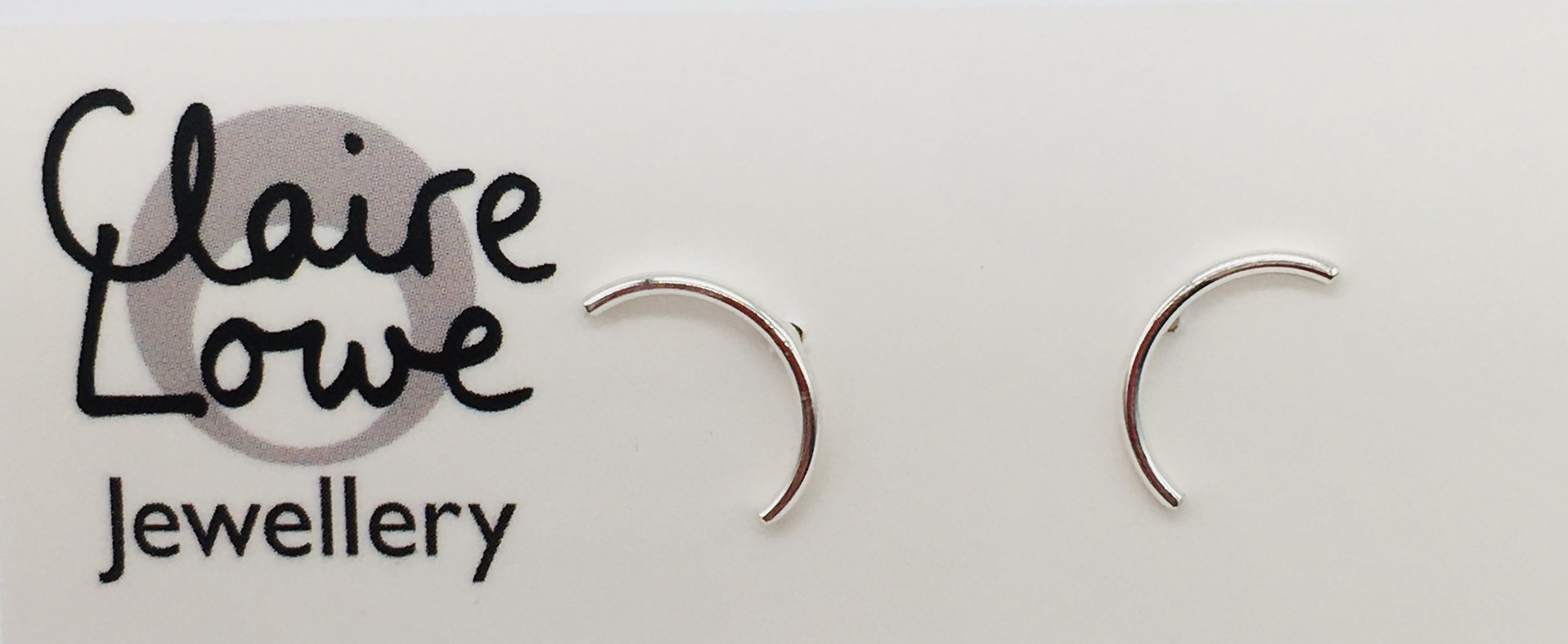 Silver arc studs for sale, handmade in Devon by silversmith Claire Lowe.