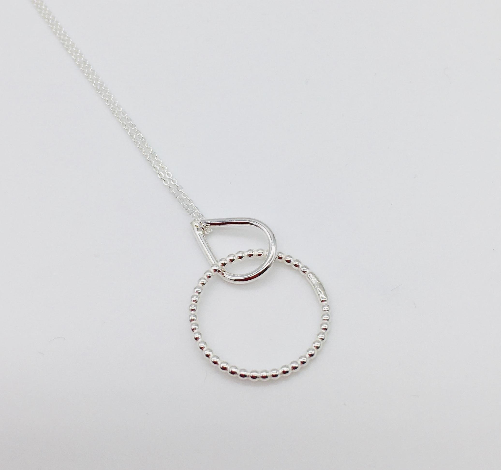 Teardrop/dotty circle pendant in silver, handmade in Devon by silversmith Claire Lowe
