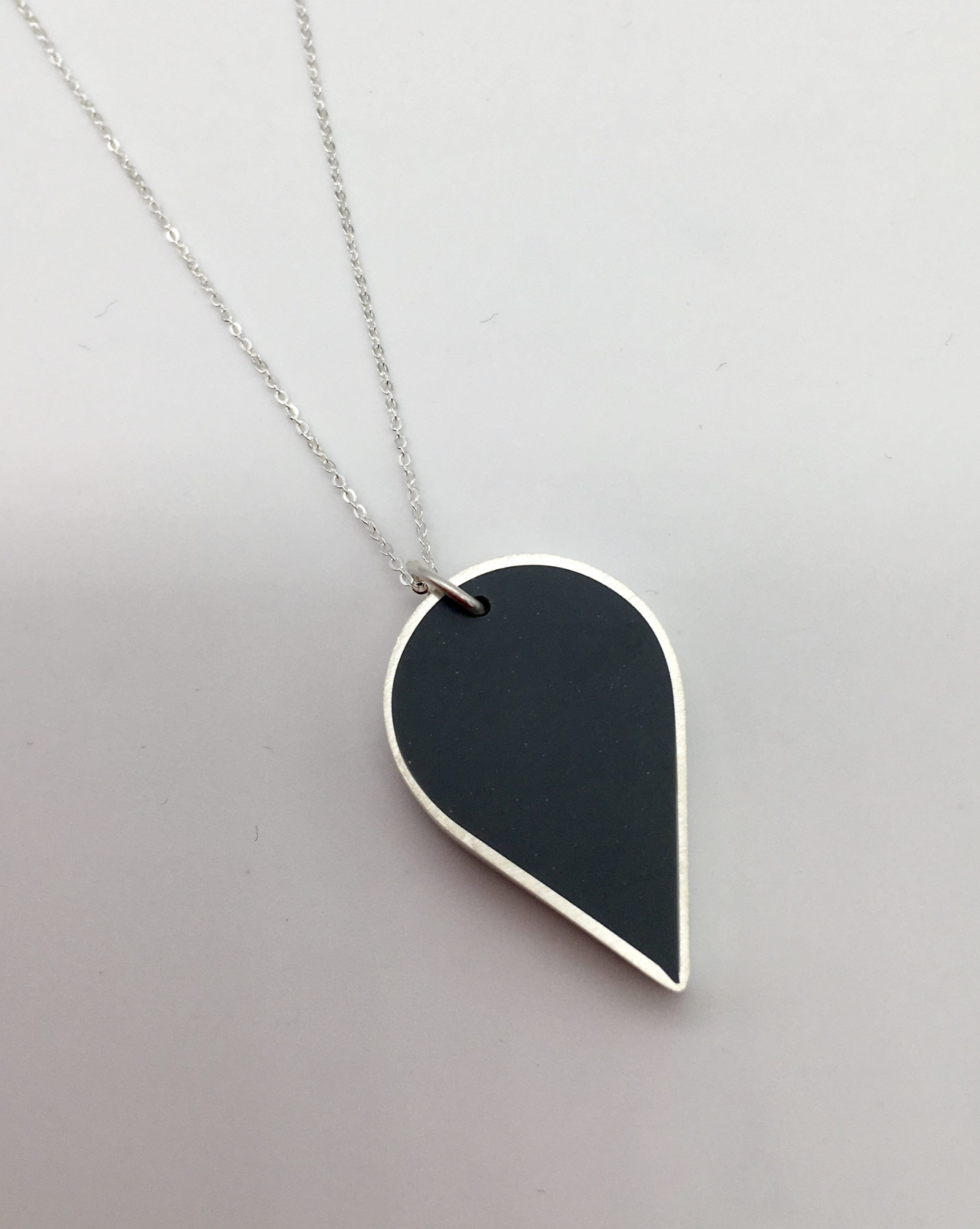 Silver and grey teardrop pendant for sale. Handmade in Devon by silversmith Claire Lowe.