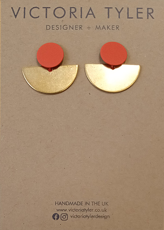 Semi circle brass earrings by Victoria Tyler. Contemporary, art deco jewellery.