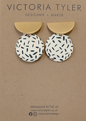 Dashed circle brass earrings by Victoria Tyler. Contemporary, art deco jewellery