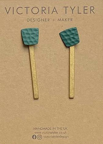 Long brass earrings by Victoria Tyler. Contemporary, art deco jewellery