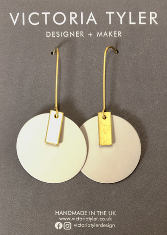 Circle with gold brass earrings by Victoria Tyler. Contemporary, art deco jewellery
